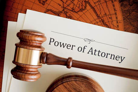 Picture of a judge's gavel sitting on top of Power of Attorney paperwork